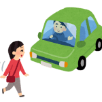 歩行者に道を譲る自動車